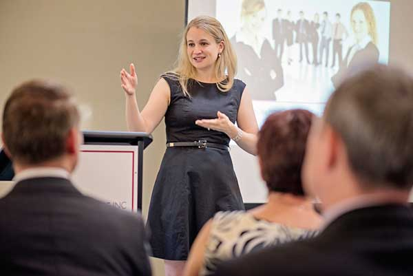Photo of Alicia speaking at a keynote event in Perth